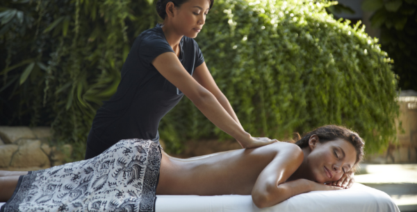 A woman is getting a massage in the Rock Spa.