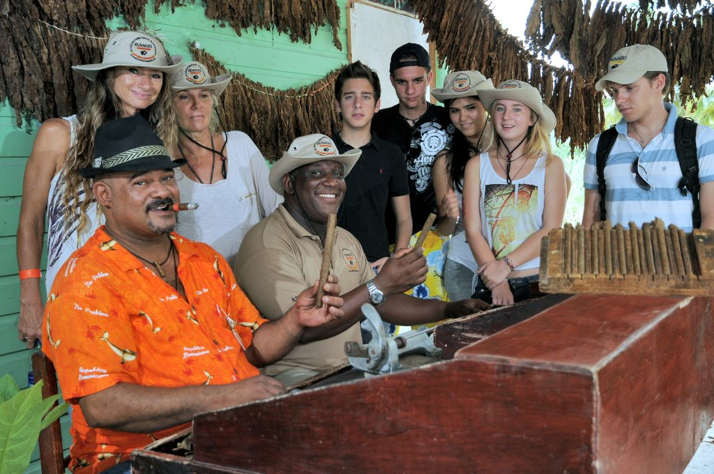 Vacationers find out how a cigar is made on our Bavaro Runners tour.