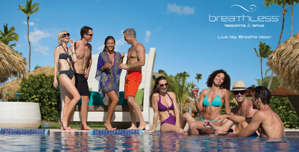A group of adult friends hang out next to the pool enjoying the company and sunny day.
