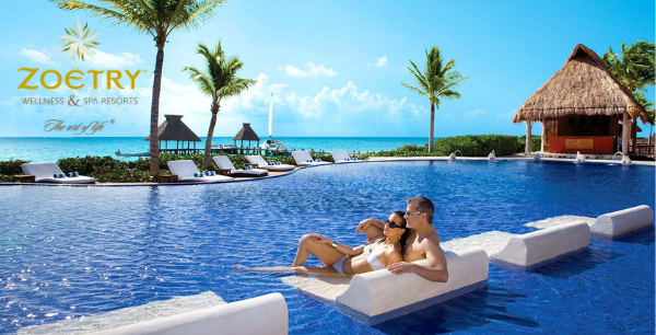 A couple enjoys the ocean view from the pool's chair.